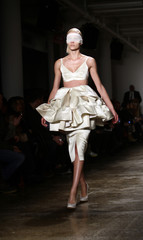 A model presents a creation from the Alexandre Herchcovitch Autumn/Winter 2013 collection during New York Fashion Week
