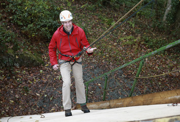 Britain's Prince William abseils as he visits the Towers Residential Outdoor Education Centre in Capel Curig
