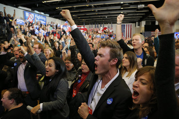 Supporters cheer as they watch returns come in at U.S. Democratic presidential candidate Hillary Clinton's caucus night rally in Des Moines