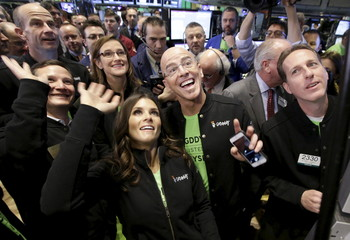 Go Daddy CEO Blake Irving and NASCAR driver Danica Patrick enjoy web hosting company GoDaddy's initial public offering at the New York Stock Exchange