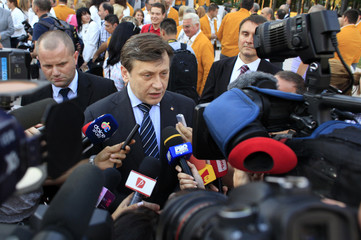 Romania's interim President Antonescu speaks to the media after a ceremony introducing the country's athletes for the London Olympics in Bucharest