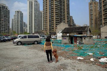 The Wider Image: Shanghai's nail naighbourhood
