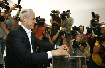 Former Serbian President and Democratic Party leader Tadic casts his vote at the polling station in downtown Belgrade