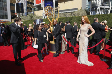 """Patrick Adams takes a photo of """"Suits"""" co-star Sarah Rafferty at the 2014 Creative Arts Emmy Awards in Los Angeles"""