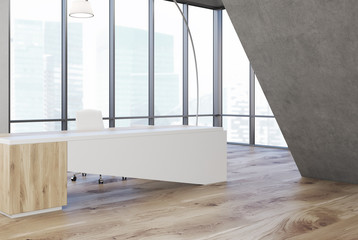 Gray triangular office, white table, side