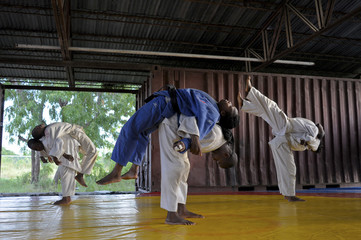 Haiti's Linouse Desravines stretches with other judokas during a training session in Port-au-Prince
