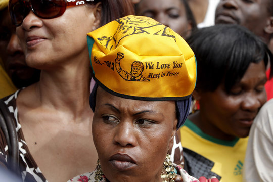 Frustrated mourners gather behind police cordons after being denied entry to the site where former South African President Nelson Mandela is lying in state in Pretoria