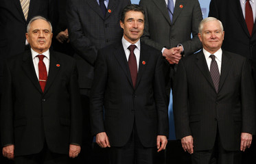 NATO Secretary-General Rasmussen poses with Gonul and Gates for a group photo during the informal meeting of NATO Defence Ministers in Istanbul