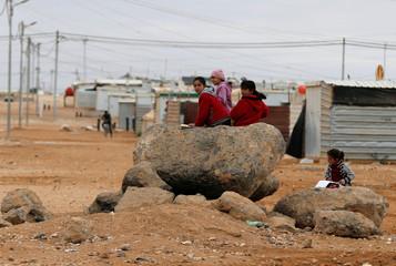 Syrian refugee children play at Al Zaatari refugee camp in Jordan, near the border with Syria