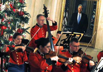 A portrait of former U.S. President Clinton hangs in the background as the U.S. Marine Chamber Orchestra performs during a Hanukkah reception in the White House at Washington
