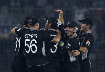 New Zealand's Oram is congratulated after taking the wicket of South Africa's Botha during their Cricket World Cup quarter-final match in Dhaka