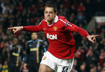 Manchester United's Javier Hernandez celebrates after scoring against Olympique Marseille during their second leg round of sixteen Champions League soccer match  at Old Trafford in Manchester