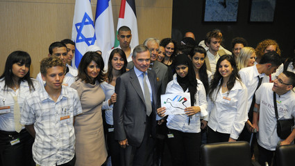 Palestinian Hala Maged Gool holds a peace dove drawing as she poses with French National Assembly speaker Accoyer at the National Assembly in Paris