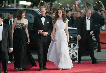 BAFTA Chief Executive Berry, Britain's Prince William and his wife Catherine, Duchess of Cambridge, walk the red carpet as they arrive at the BAFTA Brits to Watch event in Los Angeles