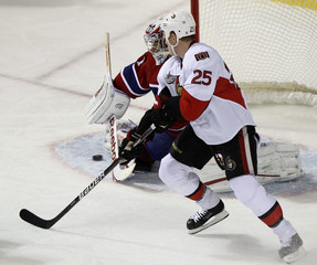Canadiens goalie Price makes a save against Senators Neil during NHL hockey action in Montreal