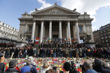 The Brussels Philharmonic Orchestra plays on the steps of the old stock exchange building Brussels following Tuesday's bombings in Brussels.