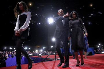 U.S. President Barack Obama (2nd R) is joined onstage by first lady Michelle Obama and daughter Malia, after his farewell address in Chicago