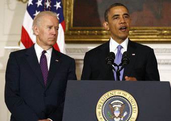 U.S. President Obama speaks next to Vice President Biden about the devastating tornadoes and severe weather impacting Oklahoma, in Washington