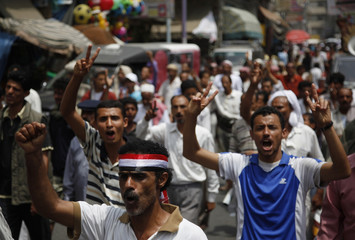Anti-government protesters shout slogans during a demonstration in the southern city of Taiz