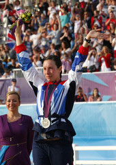 Britain's Samantha Murray celebrates as she receives her silver medal during the victory ceremony for the women's modern pentathlon during the London 2012 Olympic Games