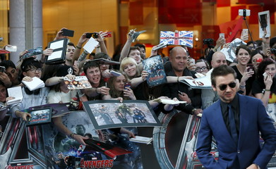 """Fans react as cast member Jeremy Renner poses at the european premiere of """"Avengers: Age of Ultron"""" at Westfield shopping centre, Shepherds Bush, London"""