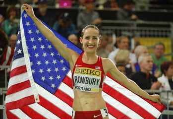 Rowbury of the U.S. poses with an American flag after winning the bronze medal in the women's 3000 meters during the IAAF World Indoor Athletics Championships in Portland