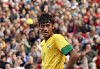 Brazil's Neymar stands on the field during their men's Group C football match against Belarus at the London 2012 Olympic Games at Old Trafford in Manchester