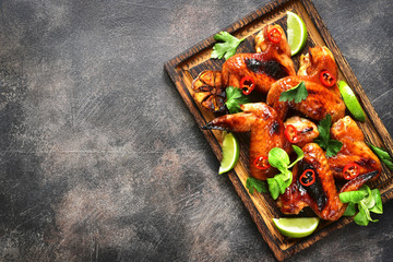 Grilled spicy chicken wings.Top view with copy space.