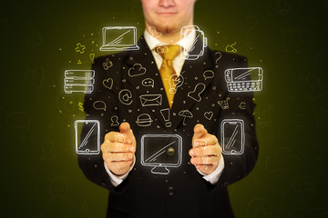 Businessman holding networking icons