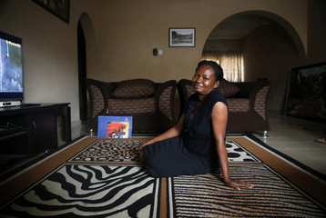 Fashion designer Omobola Omowunmi, an ethnic Yoruba Christian woman, poses for a portrait in the living room of her home in Oregun district in Nigeria's commercial capital Lagos