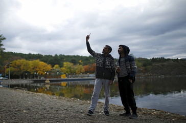 Tourists take selfie on the banks of the Lisi Lake in Tbilisi