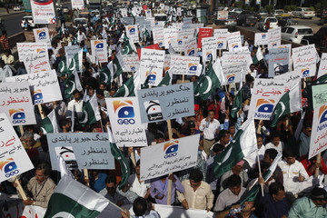Employees of Pakistan's biggest television station Geo TV attend a protest in Karachi