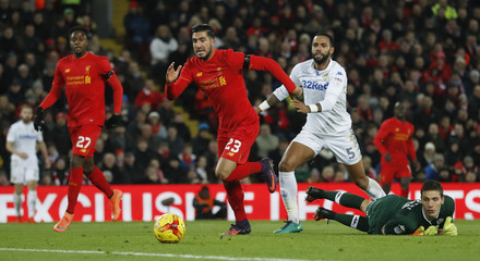 Liverpool's Emre Can shoots wide