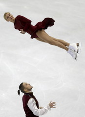 Tatiana Volosozhar and Maxim Trankov of Russia perform during the pairs free program at the ISU European Figure Skating Championship in Bratislava