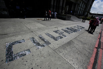 "Word  ""Culpable"" (Guilty) is spelled out with toy soldiers displayed in front of the National Palace as International Day of the Victims of Enforced Disappearances is observed in Guatemala City"