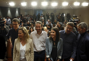 Podemos (We Can) party leader Iglesias and deputies pose before a news conference at Parliament in Madrid