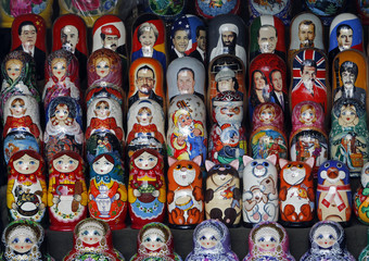 A selection of Russian nesting dolls showing public figures, cartoons characters and world leaders is on display on a stall near Moscow's Red Square