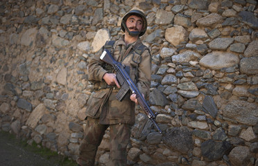 A Pakistani soldier Ismail Khan stands guard in a village in Khar