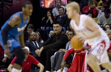 Houston Rockets center Yao Ming of China watches from the bench during the Rockets' NBA game against the Washington Wizards in Houston