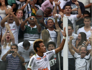 Neymar of Santos celebrates after scoring against Vasco da Gama during their Brazilian championship soccer match in Santos