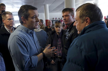 U.S. Republican presidential candidate Ted Cruz speaks with attendees at a campaign event in Hubbard