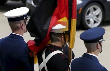German flag engulfs US honor guard during welcome cordon for German Defense Minister von der Leyen to Pentagon in Washington