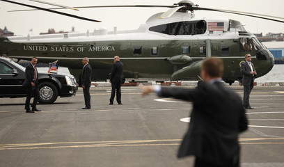 Secret Service agents stand guard as U.S. President Barack Obama lands in Marine One in New York