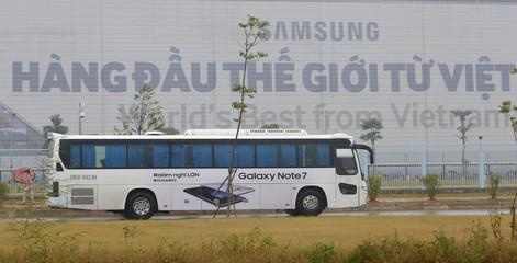 A bus, with image of the Samsung Galaxy Note 7, transports employees on the way to work at the Samsung factory in Thai Nguyen province, north of Hanoi