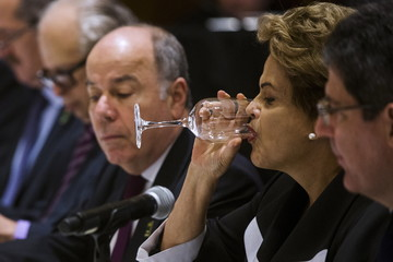 Brazil's President Dilma Rousseff drinks from a glass of water during a meeting with business leaders during a visit to the United States in New York