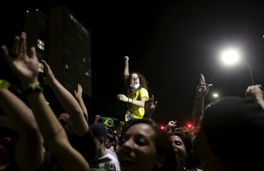 Demontrators take part in a protest against President Dilma Rousseff's appointment of former President Luiz Inacio Lula da Silva as her chief of staff, in front of the Brazilian national congress in Brasilia