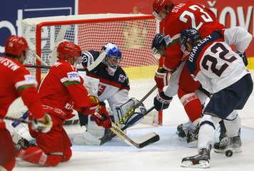 Slovakia's goaltender Laco defends in front of Kalyuzhny and Stas of Belarus during their Ice Hockey World Championship game at the CEZ arena in Ostrava