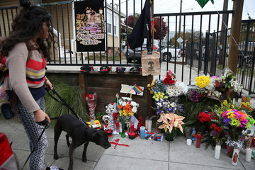 A sidewalk memorial is seen near the burned warehouse following the fatal fire in the Fruitvale district of Oakland