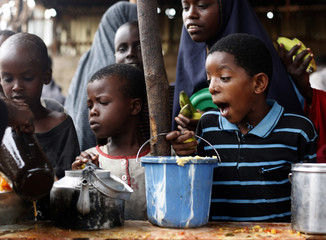 A boy reacts during a food distribution from an international NGO in Mogadishu