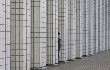 A man smokes at a business building in Tokyo